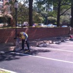 Installing wheel stops at recently completed parking lot